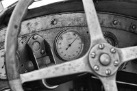 black and white picture of a steering wheel at goodwood festival of speed