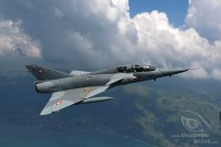 Mirage III above Thunersee with clouds in the background
