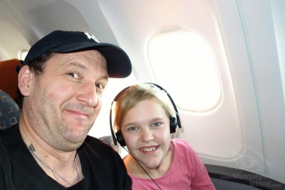 selfie of girl and is uncle in an airbus a320 outbound hamburg to london