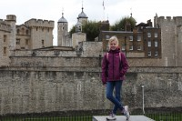 girl posing in front of the tower of london