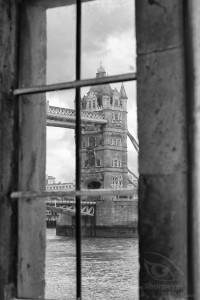 Tower Bridge seen throughout a window at tower of london