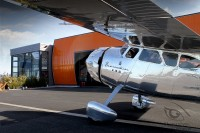 Silver polished Cessna 195 in front of Hangar 2 at Airport Paderborn Lippstadt