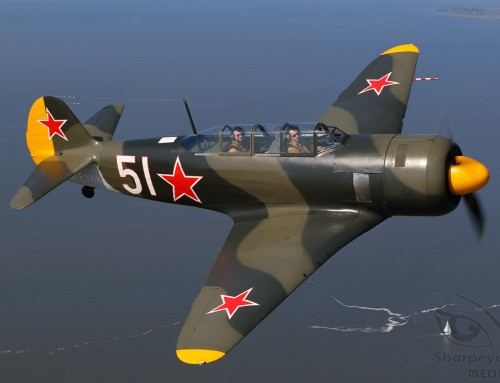 Yak-11 above the shore
